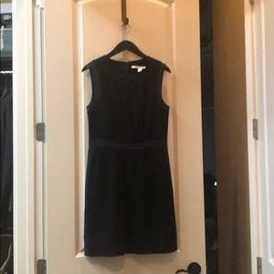 Black business dress with navy accents